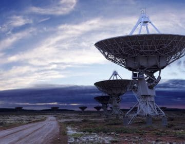 giant radio telescope satellite dishes at twilight, panoramic frame (XL)