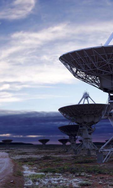 giant radio telescope satellite dishes at twilight, panoramic frame (XL)