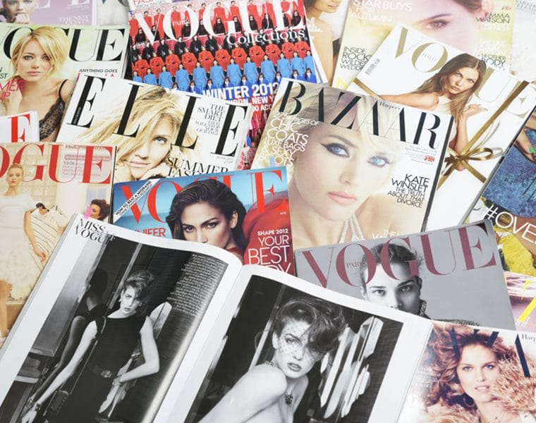 """Seoul, Korea - September 9, 2012:Studio product shot of covers and fashion spread of fashion  magazines, VOGUE, ELLE and Harper's BAZAAR for research and making up a fashion story."""